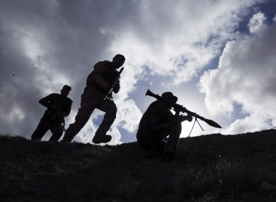 Shiite fighters clash with the Islamic State group at the frontline in Tikrit last month.