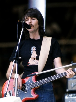 Eagles bassist Randy Meisner performing on stage, circa 1975.