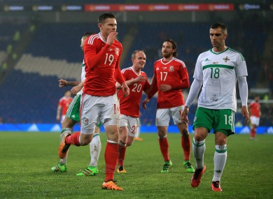 Wales' Simon Church celebrates his late equaliser.
