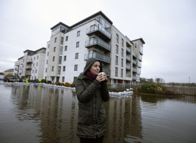 Emily Topka sips on a mug of tea outside the Bastion Apartments in Athlone, from which residents were evacuated during January.