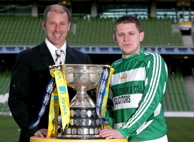 Pat Mullins of Pike Rovers with ex-Ireland captain Kenny Cunningham and the FAI Junior Cup trophy (file photo).