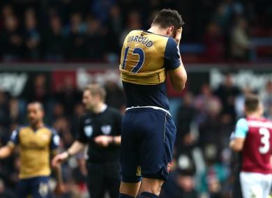 Arsenal striker Olivier Giroud holds his head in his hands