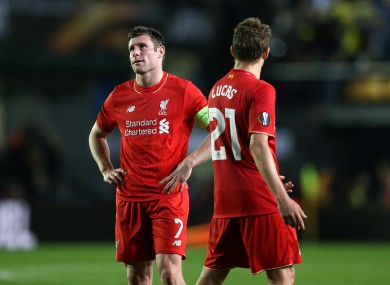 Liverpool's James Milner (left) shows his dejection after the final whistle.
