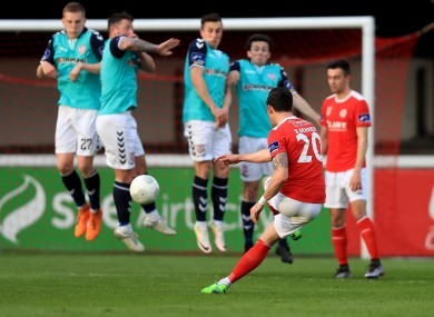 Saints winger Billy Dennehy takes a free-kick during Friday's loss to Derry.