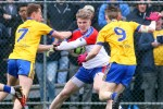 New York's Luke Loughlin (10) runs with the ball while being pursued by Roscommon's Niall McInerney (7) and Cathal Compton (9) during the first half at Gaelic Park in the Bronx.