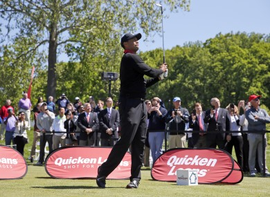 Tiger Woods watches the first of three ceremonial balls from the 10th tee during a Quicken Loans National golf tournament media availability at Congressional Country Club.