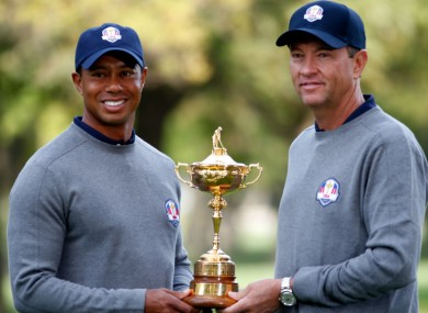 Tiger Woods and Davis Love III pose with the Ryder Cup in 2012