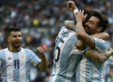 Argentina celebrate their third goal.