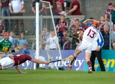 Galway's Conor Whelan scores his side's third goal despite the efforts of Tommy Gallagher of Westmeath.