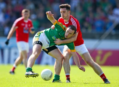 Meath's Eamon Wallace with Derek Maguire of Louth.