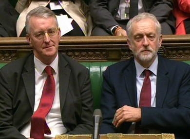 Shadow foreign secretary Hilary Benn (left) and Labour Party leader Jeremy Corbyn look on in the House of Commons.
