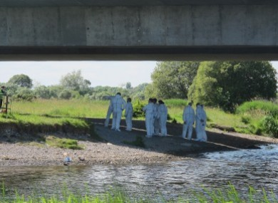 The Garda Forensic Team comb the banks of the River Shannon in June 2014.