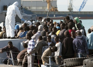 Migrants waiting to disembark from an Italian Finance Police vessel in April 2015