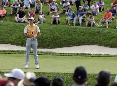 Rory McIlroy reacts after missing a putt on the 14th hole during the first round of the Memorial golf tournament.