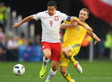 Poland's Robert Lewandowski in action against Ukraine.
