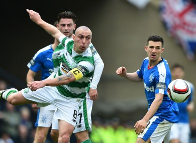 Celtic captain Scott Brown competes for the ball against Rangers