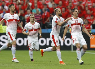 Switzerland's Fabian Schaer, right, celebrates with teammates.