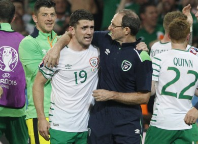 Ireland coach Martin O'Neill hugs Robbie Brady as they celebrate at the end of the Euro 2016 Group E soccer match.