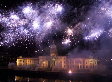 Dublin's Custom House lit up by fireworks during the St. Patrick's Day Festival in the year 2000.