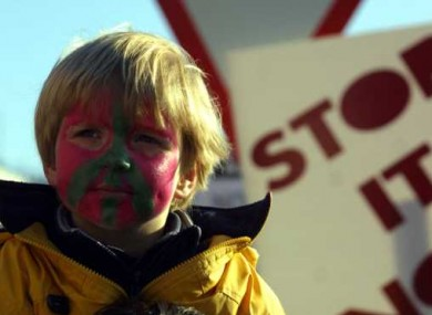 A boy painted with the peace symbol joins in the 2003 Dublin protest against the Iraq War