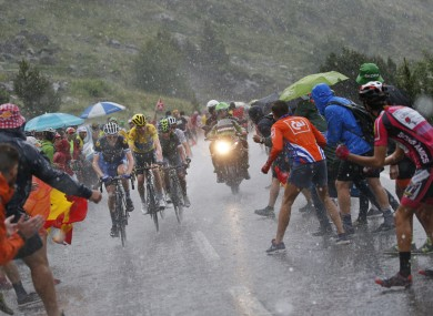 Martin, far left, and the rest of the peloton had to battle testing weather on Sunday.