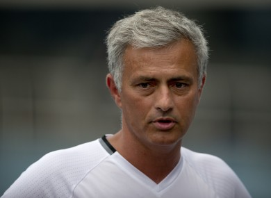 Manchester United manager Jose Mourinho speaks to the media before the team's training session at the Olympic Sports Center Stadium in Beijing.
