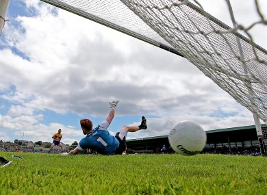 David Tubridy slots a penalty past Sligo goalkeeper Aidan Devaney.