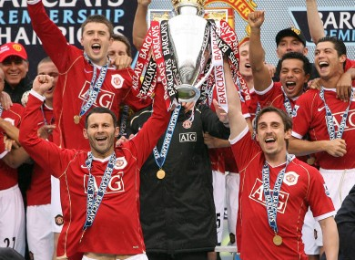 Manchester United's Ryan Giggs (left) and Gary Neville (right) lift the Premier League trophy in 2007.
