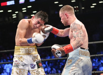 Carl Frampton, right, lands a punch on Leo Santa Cruz during their WBA Super World Featherweight Championship fight at the Barclays Center in the Brooklyn borough of New York on Saturday.