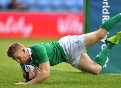 Stephen Kerins runs in a try during the World Rugby U20 championship.