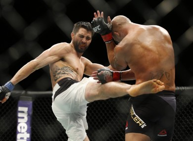 Carlos Condit lands a body-kick during his welterweight title bout against champion Robbie Lawler in January.