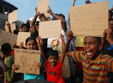 Sri Lankan asylum seekers who were caught in Indonesian waters while trying to sail to Australia.