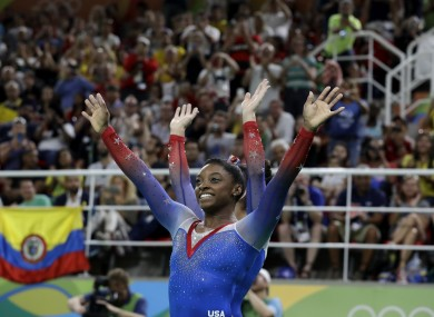 United States' Simone Biles greets the crowd after winning gold for floor during the artistic gymnastics women's apparatus final.