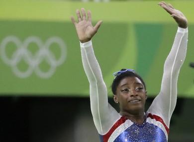 United States' Simone Biles celebrates after winning gold.