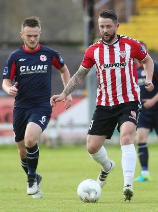 Derry goalscorer Rory Patterson with David Cawley of St Pat's.