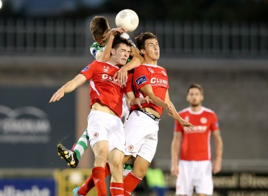 Sean Boyd, Lee Desmond and Jamie McGrath jump for the ball during tonight;s EA Sports cup semi-final.