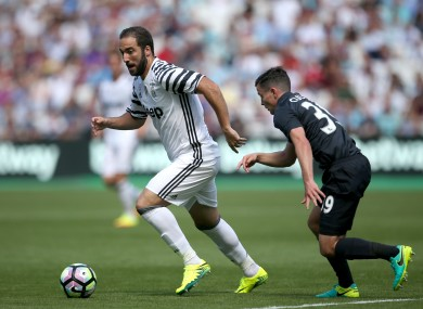 Juventus' Gonzalo Higuain (left) and West Ham United's Josh Cullen battle for the ball.
