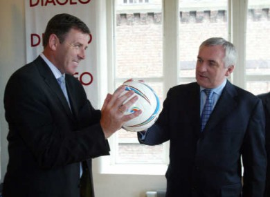 Bertie Ahern with former soccer player Packie Bonner, holding a (foot)ball