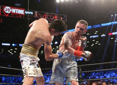 Carl Frampton catches Leo Santa Cruz with a right hand in their first bout.