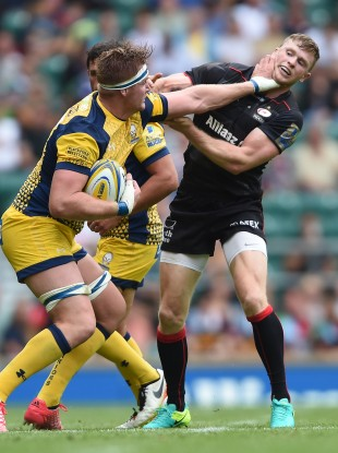Van Velze hands off Chris Ashton in the meeting with Saracens.