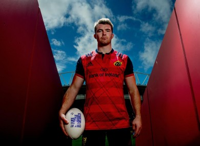 O'Mahony modelling the new Munster European jersey, which pays homage to the 2006 Heineken Cup win.