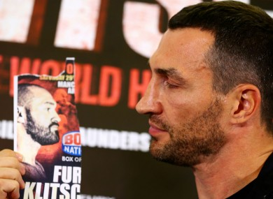 Wladimir Klitschko poses with an image of Tyson Fury, who failed to turn up for a media conference.