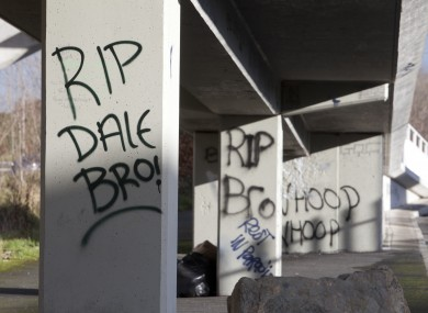 Memorials in the form of flowers, candles, flags, posters, banners and graffiti both on and under the pedestrian footbridge across the Tallaght Dual Carriageway, on which Dale Creighton was seriously assaulted