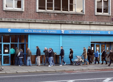 (File photo) People queue outside the Social welfare offices in Thomas Street Dublin in 2009