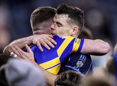 Dublin team-mates Ciaran Kilkenny and Kevin MacManamon hug after the final whistle.