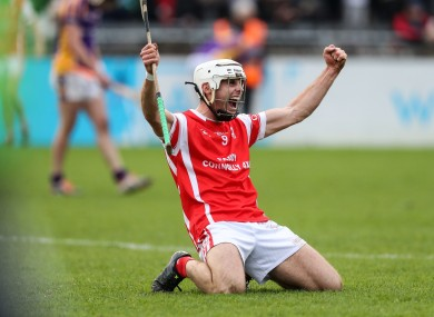 Cuala midfielder Darragh O'Connell celebrates at the final whistle.