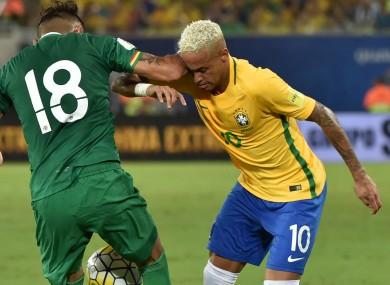 Bolivia's Yasmani Duk vies with Neymar of Brazil.