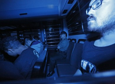 Rurik Jutting, right, a British banker, sitting in a prison bus, leaves a court in Hong Kong in 2015 (File photo)