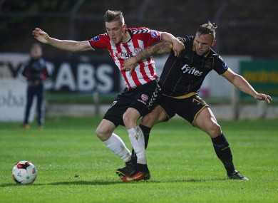 Derry's Ronan Curtis with Paddy Barrett of Dundalk.