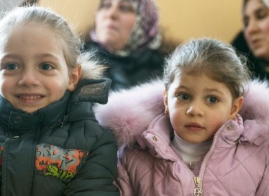 Refugees from Aleppo attend a meeting in Losino-Petrovsky, about 52km northeast of Moscow, Russia.